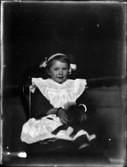 Portrait of young girl in white smock (Powerhouse Museum Collection) Tags: portrait blackandwhite dog classic girl puppy chair ribbons child young apron littlegirl smock powerhousemuseum braclet sitt xmlns:dc=httppurlorgdcelements11 dc:identifier=httpwwwpowerhousemuseumcomcollectiondatabaseirn385742 pinifore