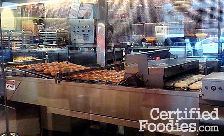Krispy Kreme rolling off fresh glazed doughnuts - CertifiedFoodies.com