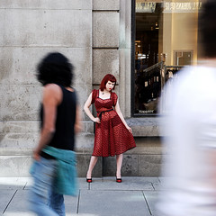 Causing a commotion (Rune T) Tags: street red portrait people blur oslo contrast pose fun outside movement looking dress redhead freeze lydia moment attention timing pinkham abigfave guyslooking