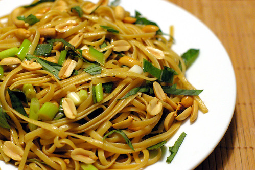 Spicy Sesame Noodle with chopped nuts and Thai Basil