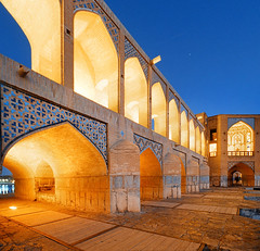 Khaju Bridge Blue Hour (zerega) Tags: old city blue sunset fab people orange cold brick art history water architecture contrast vintage tile ceramic relax geotagged evening town persian twilight asia warm stair gallery mood arch iran dusk middleeast persia stack historic unescoworldheritagesite complementary step level hour repetition stroll esfahan rhythm repeat iteration isfahan weir azulejos sluicegate khajoo persien zayandehriver khajubridge polekhajoo shahabbasii octagonalpavilions lpvibrant