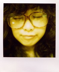 bang! (Jersey Yen) Tags: selfportrait polaroid cartoon curly jersey  inmyroom funnyglasses arale drslump yellowish myeverydaylife sx70sonar closedmyeyes withoutndfilter