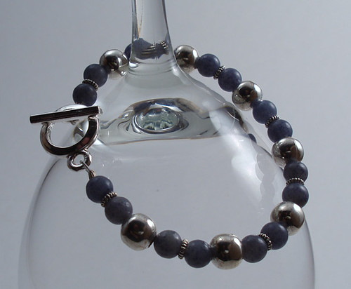 Blue Quartz and Silver Toggle Bracelet on Glass