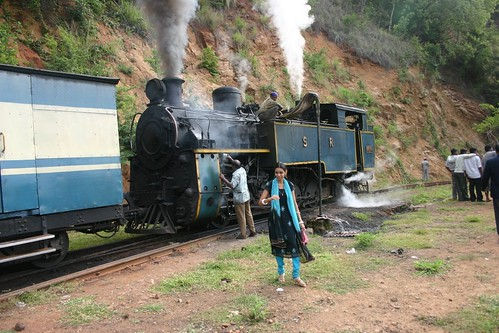 A steam train, the Nilgiri Express, pushed us up the mountain