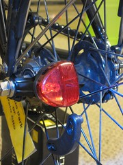 Reelight red tail light on rear wheel