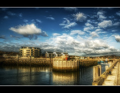 Rolling Into Port (Finntasia) Tags: blue winter sea sky sun water clouds port pier harbour jetty dorset chapeau hdr bridport westbay thegoldengallery theoldport qtpfsgui amomentarylapseofreason finntasia diamondstars goldstaraward multimegashot vanagram sensationalphoto nigelfinn