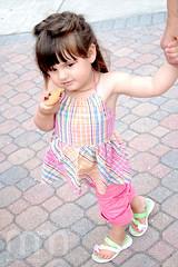 Yummy (Bryan Miller) Tags: girl cookie child portfolio holdhands