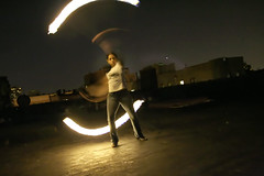 fire spinning practice (Lobster Rocket) Tags: roof party sky brooklyn night buildings fire lights spin poi firebird practice weekly prospect hieghts grandspace hardtoshootinthedark whenyouleaveyourpolarizeron