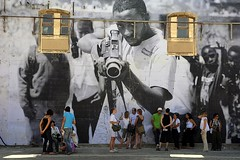 JR in Arles (Hughes Lglise-Bataille) Tags: france color topf25 photo topf50 nikon mural photographer jr d200 arles ateliers 2007 sncf rencontres topv1000