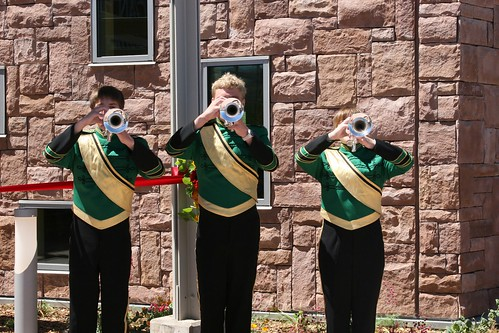 Trumpet fanfare by members of Live Oak High School Emerald Regime Band