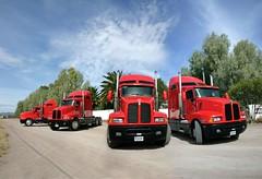 Camiones (sdls) Tags: blue red sky verde green azul photoshop exterior background cielo trucks fondo trailers camiones rojos