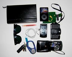 (menamachines) Tags: camera black moleskine bag keys glasses lomo nikon ipod phone cellphone coolpix headphones glowstick carry chapstick d80 nikond80