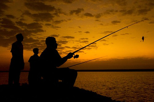 Fishing - Silhouette by Hussain Isa.