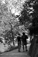 a walk in the park (jakarachuonyo) Tags: autumn blackandwhite iso100 couple walk maryland cocanal greatfallsnationalpark aperturef4 focallength75mm canonrebelxti lenscanonef75300mmf456 shutterspeed1200sec washingtonphotographymeetupgroup