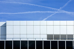 White City trails (Stringendo) Tags: building architecture trails bluesky whitecity contrails vapour