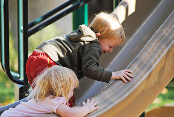 Kids-climbing-up-slide--wm