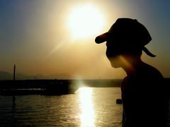 sunbeams (mokotowska) Tags: boy sunset sea people sun silhouette sunbeam sunbeams