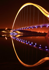 Infinity Bridge Night Shot - Middlesbrough (capturedcanvas.co.uk) Tags: pictures uk longexposure nightphotography travel bridge blue light art digital canon reflections landscape photography lights landscapes photo holidays long exposure nightshot bright north shoreline picture dramatic canvas printing empire colourful middlesbrough northeast sillhouette xsi longshutterspeed 450d canon450d photosoncanvas nighttimelongexposure empireart photographywallart