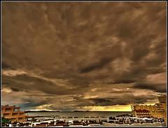 OVER THE ROOFS (Pepe Roselló) Tags: sea sky panorama seascape storm clouds sunrise canon island mar mediterranean mediterraneo paisaje amanecer ibiza cielo nubes tormenta eivissa treatment mediterranee santaeulalia canon1785isusm canoneos1000d