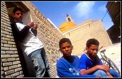 Alley Kids.jpg (jjay69) Tags: blue bicycle kids alley glare northafrica tunisia muslim islam mosque shirts dome stare brotherhood islamic muslimcountry