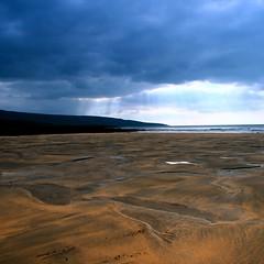 sand sea sky (limerickdoyle) Tags: blue ireland light sea sky beach sand clare bluesky atlantic burren through shining costal countyclare besidethesea lookingsouthwest efs1785mm irishlandscape canon400d cokinp122 skytosand