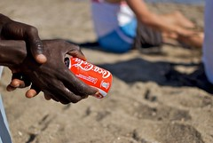 man holding coca-cola can at the beach (MatiasSingers) Tags: beach coke can soda cocacola malaga malagaspain redcan