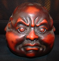 angry buddha sculpture