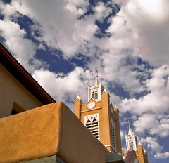 San Felipe de Neri Church (benrobertsabq) Tags: blue orange brown white newmexico clouds cross tan albuquerque historic abq crucifix nm polarizer oldtown stucco sanfelipedenerichurch anawesomeshot flickrmeetlite