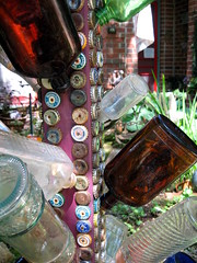 Nina's bottle tree (Pandorea...) Tags: art garden post bottles folk outsider bottletree avantgarden bottlecaps invited