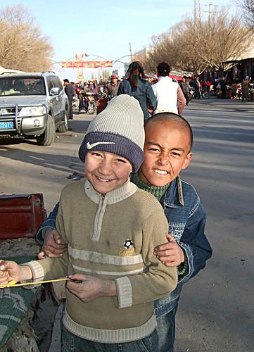 Uyghur boys, Bazaar, Niya / Minfeng, Xinjiang, China by centralasiatraveler