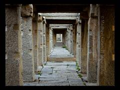 Pillared Pathway (Bindaas Madhavi) Tags: travel india temple temples bazaar karnataka pillars incredible 14thcentury hampi stoneart bindaas vitthala madhavikuram mkuram hopset