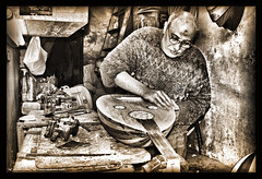 Lutes maker-Egypt (khalid almasoud) Tags: camera old man st shop sepia work ancient nikon photographer antique hard january egypt professional ali cairo journey age maker khalid georges mohammad lute emery 2007   lutes    8800 gamil          almasoud  aplusphoto