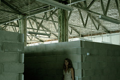stuck behind the corner (CristinaO) Tags: woman girl architecture construction sofia cement materials lamplights