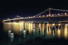 Bay Bridge (Take 5?) - San Francisco, California (Jim Patterson Photography) Tags: sanfrancisco california longexposure nightphotography bridge bay pier nikon bridges 101 pacificocean baybridge embarcadero pilings nikkor 1224mm sfbay d300 beneathblueseas beneathblueseascom jimpattersonphotography jimpattersonphotographycom seatosummitworkshops seatosummitworkshopscom