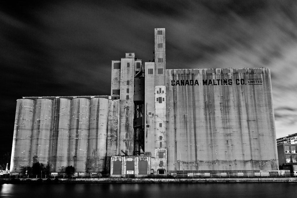 long exposure picture of the canada malting co. ltd. plant in toronto at night taken from the marina queens quay west