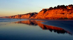 Blacks Beach Sunset, San Diego, California (moonjazz) Tags: california park blue sunset vacation favorite orange cliff black west reflection beach nature beautiful beauty wonderful sand perfect surf waves glow peace flat natural pacific sandiego walk tide low hike best erosion beaches end serene geography bliss stroll wealth