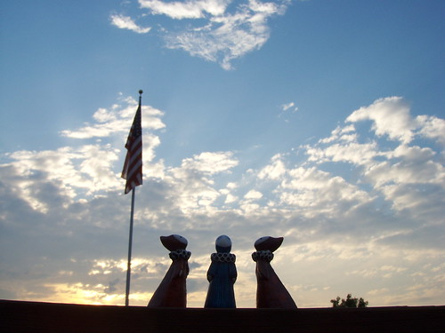 poppets, flag and clouds