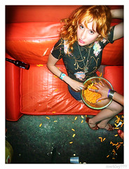 Rachel H. - Posing on a Crappy Orange Sofa With A Bowl of Cheetos and Jenny's Grabby Hand in Von Iva's Dressing Room @ 12 Galaxies (merkley???) Tags: sanfrancisco california portrait musician usa rock darkroom photoshop rachel saturated photoshopped jenny plastic portraiture cheetos keyboards backstage oversaturated retouched excess airbrush toomuch 12galaxies overdone airbrushed cheesepuffs creepyhand rachelh digitaldarkroom threequestionmarks threequestionmarkscom merklefied merklefication