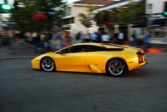 Yellow Lamborghini Murcielago (j.hietter) Tags: auto italy art car yellow night digital gold monterey italian nikon action whole exotic giallo pebblebeach panning lamborghini coupe supercar midas murcielago wholecar d80 18135mm