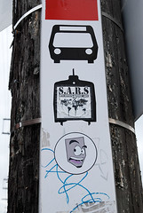Toronto Graffiti 8534 (sniderscion) Tags: street urban toronto ontario canada art face sign altered scott graffiti nikon sticker funny ttc canadian transit infrastructure modified tamron f28 snider subversion subverted d80 1750mm tamronspaf1750mmf28 sniderscion