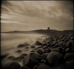 dunstanburgh castle (Stuart Griffin) Tags: longexposure holga toycamera northumbria toned questfortherest dunstanburghcastle