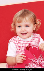 Two year old girl holding paper hearts (five2b4u) Tags: old red 2 two portrait baby holiday cute love girl smile face childhood vertical loving female project paper out children hearts happy one kid big holding toddler day child heart 14 year innocent daughter young valentine romance special jacket blond gift laugh blonde valentines romantic folded preschool fold february 14th toddlers celebrate olds caucasian celebrartion