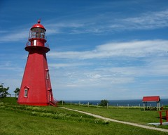 Phare de La Martre (Lilia) Tags: blue red sea mer lighthouse canada green beach water river golf rouge eau gulf quebec riviere vert bleu stlaurent plage phare gaspesie fleuve gaspe gaspsie gasp estuaire 10faves lamartre superhearts