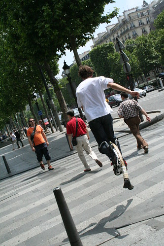 Jumping on stilts on the champs élysés