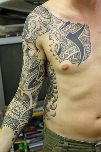 tribal art tattoo design in the body
