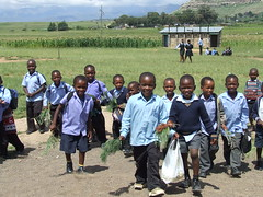 Schoolkids at Ha Nqabeni Lesotho greeting me on World Vision visit 1st March 2006 [Photo by Fihliwe] (CC BY-SA 3.0)