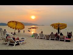 Patong Beach (Hueystar) Tags: ocean sunset sea beach water thailand sand phuket patong umbrellas