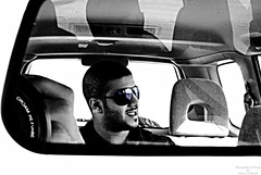 Stay On The Back Seat (Khaled Al Sharah) Tags: world auto life city portrait sky bw man black color art smile look car sport silver project fun happy photography design photo blackwhite kid al nice fantastic paint gallery day colours shot state image time action sony feel moda performance dream picture lifestyle style happiness pic international motor projects kuwait alpha dslr job powerful khaled picnik global q8 dasman a300  sharah        p2bk alsharah