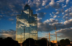 Sunrise Clouds over Torrelit (not an HDR) (Ricardo Carreon) Tags: building topv2222 clouds skyscraper sunrise reflections mexico topf50 topf75 edificio explore amanecer topv5555 nubes nuvens feed straight topv9999 topv11111 topf150 topv3333 topv4444 topf100 reflexion topf250 topf200 coahuila saltillo predio topv8888 topv7777 topf175 supershot 100faves 50faves nothdr challengeyouwinner superaplus aplusphoto diamondclassphotographer superhearts explore20jun2007 thegoldenmermaid goldstaraward 275faves