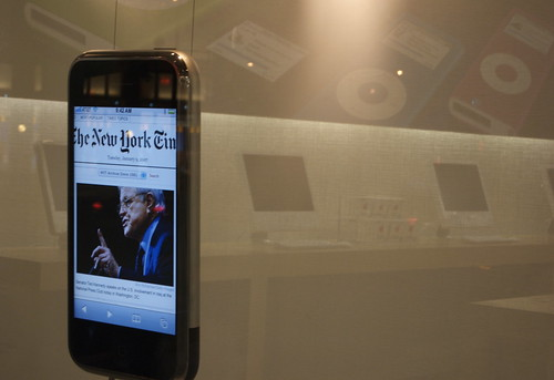 big iPhone in Apple store window displaying New York Times